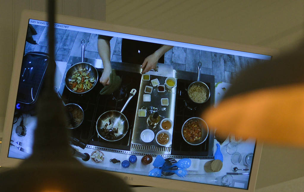Justin Sheely | The Sheridan Press<br /> A monitor lends an overhead view of the instructor's demonstration during a cooking class at Verdello Olive Oils & Fine Foods in Sheridan Wednesday, March 21, 2018.