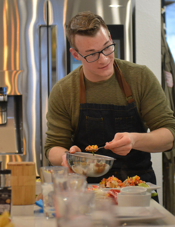 Justin Sheely | The Sheridan Press<br /> Guest instructor and nutritionist Jack Achenbach of Philadelphia, Tennessee, demonstrates how to make street tacos during a cooking class at Verdello Olive Oils & Fine Foods in Sheridan Wednesday, March 21, 2018.