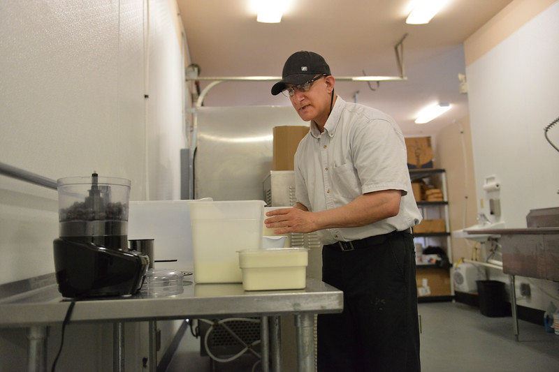 Justin Sheely | The Sheridan Press<br /> Business owner Louis Mitchell mixed ingredients for making blueberry ice cream at the Cowboy Creamery on North Main Street Tuesday, June 5, 2018.