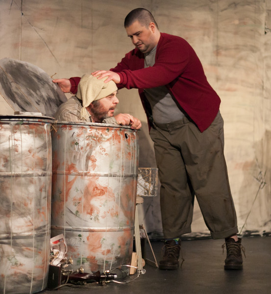 "Tibby McDowell | The Sheridan Press<br /> Nathan Goehring, as Clov, right, gives John Goodell, as Nagg, a shove back into his barrel during a dress rehearsal of the Civic Theatre Guild's production of Samuel Beckett's ""Endgame"" at the Carriage House Theater Thursday, March 22, 2018."