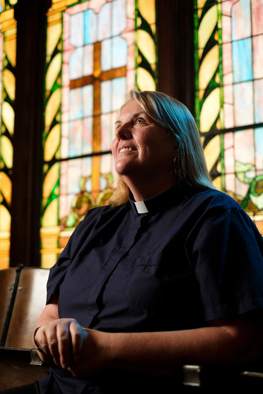 Justin Sheely | The Sheridan Press<br /> Rev. Sheila Naismith sits in front of her favorite stained glass window at First Congregational United Church of Christ in Sheridan Tuesday, May 15, 2018. Rev. Naismith was installed as the first female minister in the church's history.