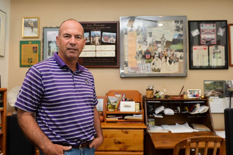 Justin Sheely | The Sheridan Press<br /> Jim Benepe stands in front of a wall of memorabilia at his home in Sheridan Friday, June 29, 2018. Thirty years ago, Benepe outshot the best golfers in the world to win his first-ever PGA Tour start – claiming the 1988 Beatrice Western Open Championship.