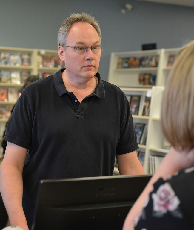 Justin Sheely | The Sheridan Press<br /> Owner Jeff Price helps a customer at the Video Depot Wednesday, March 21, 2018. The Video Depot on Coffeen Avenue is closing after more than 19 years of business in Sheridan.
