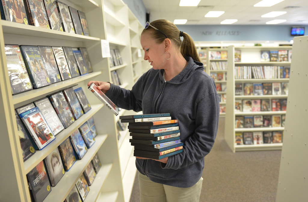 Justin Sheely | The Sheridan Press<br /> Kera Manor gathers videos on clearance at the Video Depot Wednesday, March 21, 2018. The Video Depot on Coffeen Avenue is closing after more than 19 years of business in Sheridan.