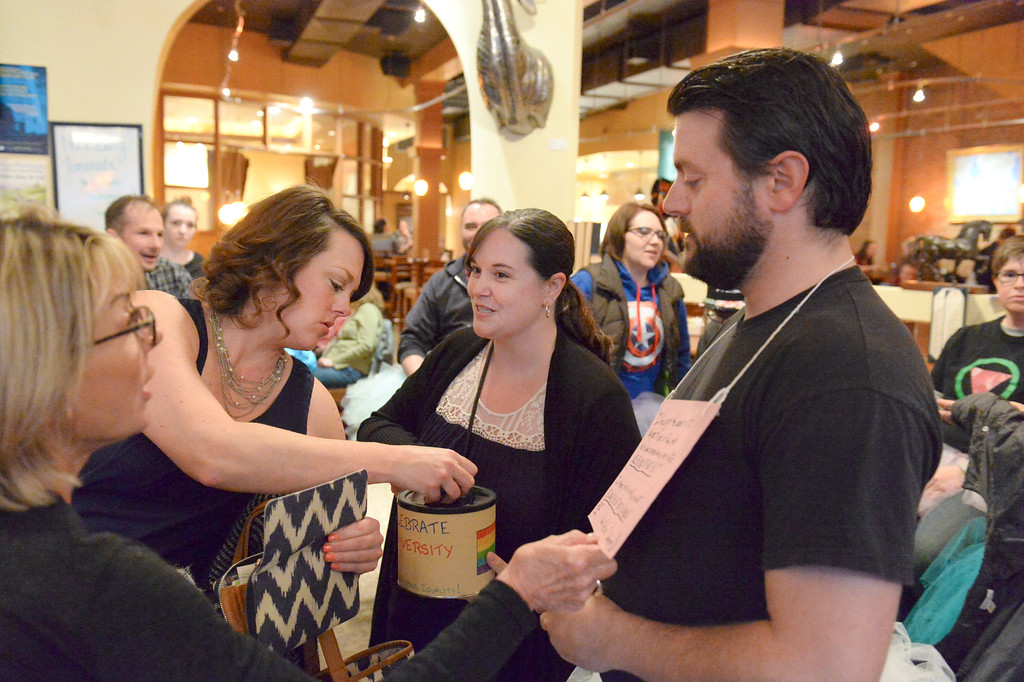 "Justin Sheely | The Sheridan Press<br /> Trish Kost, left, and Tamara Davidson visit with tutu-wearing activists Amber Hanson and David Myers for the ""Live and Let Tutu"" response Saturday night at Frackelton's. Sheridan residents took part in a state-wide response to comments made by U.S. Sen. Mike Enzi, R-Wyoming, to middle school students in Greybull on April 20, when he was asked about federal protections for LGBT people. The senator reportedly said that he knows a guy who wears a tutu to bars and and always surprised that he gets in fights, ""he kind of asks for it a little bit."" Enzi said."