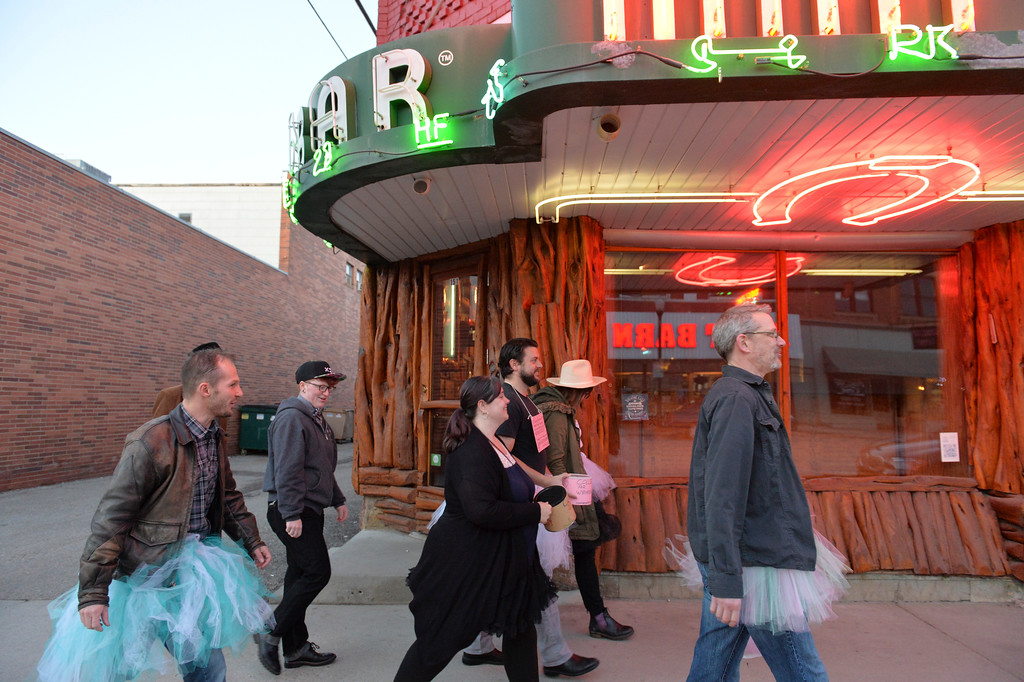"Justin Sheely | The Sheridan Press<br /> The tutu-gowned group walks past the Mint Bar along Sheridan's Main Street for the ""Live and Let Tutu"" response Saturday night. Sheridan residents took part in a state-wide response to comments made by U.S. Sen. Mike Enzi, R-Wyoming, to middle school students in Greybull on April 20, when he was asked about federal protections for LGBT people. The senator reportedly said that he knows a guy who wears a tutu to bars and and always surprised that he gets in fights, ""he kind of asks for it a little bit."" Enzi said."