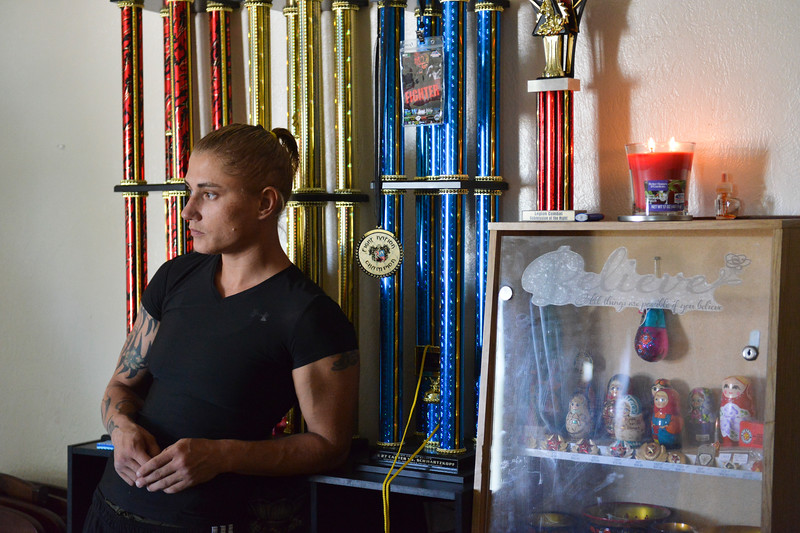 Justin Sheely | The Sheridan Press<br /> Amature MMA fighter Nekah Dmitriyeva stands by her trophies at coach Valdez's home Tuesday, June 5, 2018. Dmitriyeva and her coach are hoping to go pro after a MMA championship in Denver, Colorado, at the end of June.