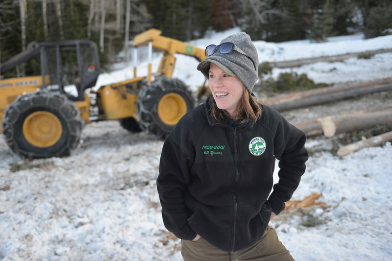 Justin Sheely | The Sheridan Press<br /> <br /> District forester Kelly Norris of the Wyoming Division of Forestry visits with her colleagues on the Wyoming State Land near Steamboat point in the Bighorn mountains Wednesday, Jan. 17, 2018.