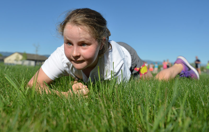 Justin Sheely | The Sheridan Press<br /> Fourth-grader Parker Treide does a low crawl for a Marine combat fitness test at Woodland Park Elementary School Wednesday, May 16, 2018.. SCSD2 health and physical education teacher Jessica Pickett brought the test to schools after attending a Marine Educator Workshop in April. Pickett believes educators can incorporate other lessons about teamwork and leadership from the Marines.