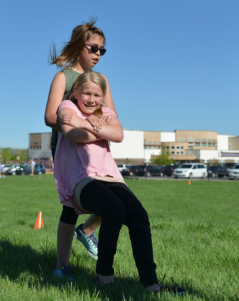 Justin Sheely | The Sheridan Press<br /> Fourth-grader Madyson Gammel drags Sophia Beld during a Marine combat Fitness test at Woodland Park Elementary School Wednesday, May 16, 2018. SCSD2 health and physical education teacher Jessica Pickett brought the test to schools after attending a Marine Educator Workshop in April. Pickett believes educators can incorporate other lessons about teamwork and leadership from the Marines.