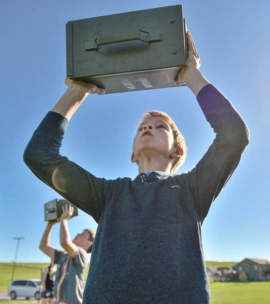 Justin Sheely | The Sheridan Press<br /> Fourth-grader Noah Gorzalka lifts a 15-pound ammo box over his head for a Marine combat fitness test at Woodland Park Elementary School Wednesday, May 16, 2018. SCSD2 health and physical education teacher Jessica Pickett brought the test to schools after attending a Marine Educator Workshop in April. Pickett believes educators can incorporate other lessons about teamwork and leadership from the Marines.
