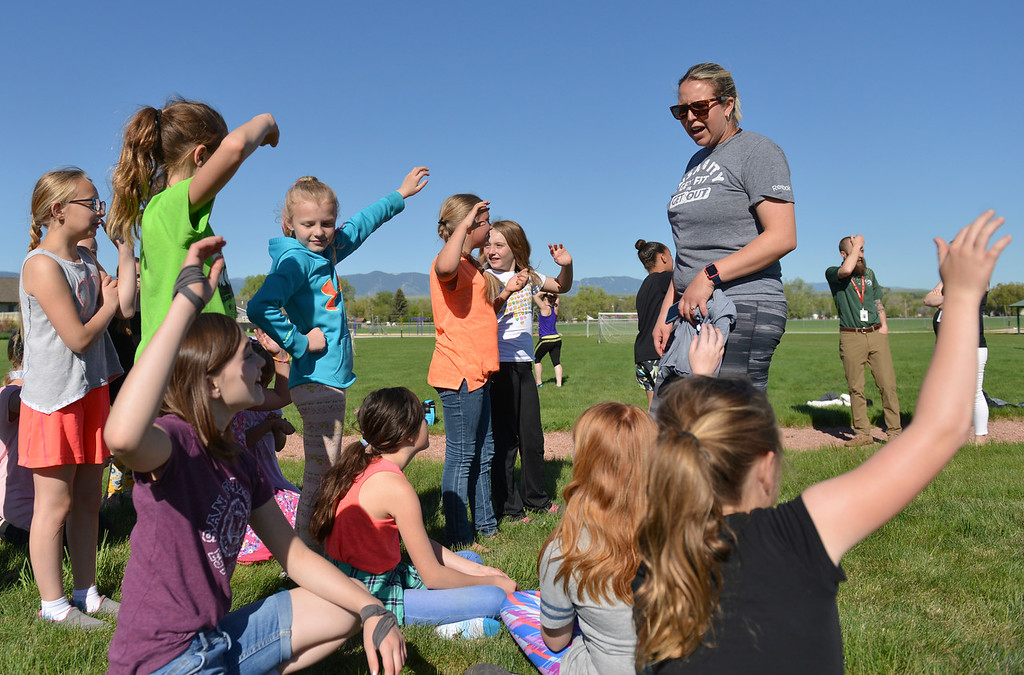 Justin Sheely | The Sheridan Press<br /> SCSD2 health and physical education teacher Jessica Pickett speaks to a group of fourth-grade girls during a Marine combat Fitness test at Woodland Park Elementary School Wednesday, May 16, 2018. Pickett brought the test to schools after attending a Marine Educator Workshop in April. Pickett believes educators can incorporate other lessons about teamwork and leadership from the Marines.