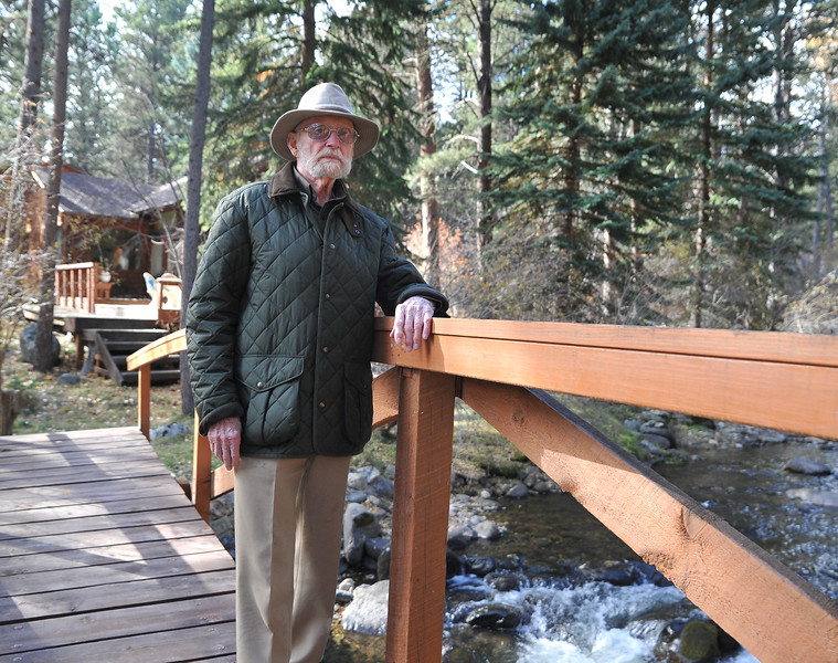 Ryan Patterson | The Sheridan Press<br /> Charles Neelley stands on a bridge in his backyard in Story Wednesday, Oct. 24, 2018. Neelley served in the Navy from 1953-83 and has lived in Wyoming since 1992.