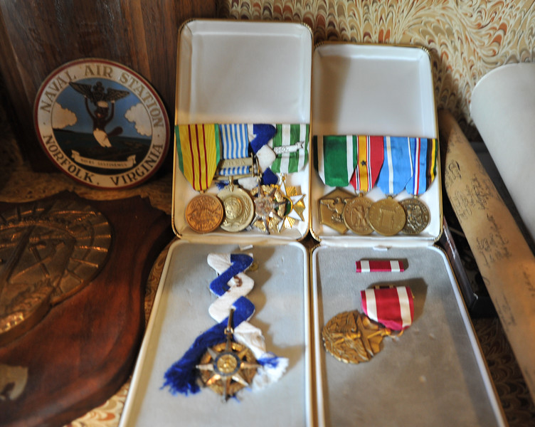 Ryan Patterson | The Sheridan Press<br /> Medals from Charles Neelley's Naval experience are displayed at his home in Story Wednesday, Oct. 24, 2018. Neelley served in the Navy from 1953-83 and has lived in Wyoming since 1992.