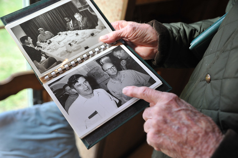Ryan Patterson | The Sheridan Press<br /> Charles Neelley points to a picture of himself, bottom right, during his time in the Navy at his home in Story Wednesday, Oct. 24, 2018. Neelley served in the Navy from 1953-83 and has lived in Wyoming since 1992.