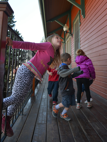 Justin Sheely | The Sheridan Press<br /> Alice Russell plays outside Sheridan Absaroka Head Start at the Historic Train Depot Tuesday, April 24, 2018.
