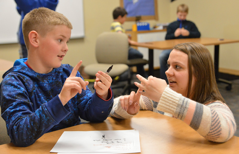 Justin Sheely | The Sheridan Press<br /> Education student Jackie Wells, right, coaches Sagebrush Elementary fifth-grader Aiden Mims as they plan out how to make a catapult during the Practicum in Education program at the Sheridan College Broadway Center Wednesday, April 4, 2018.