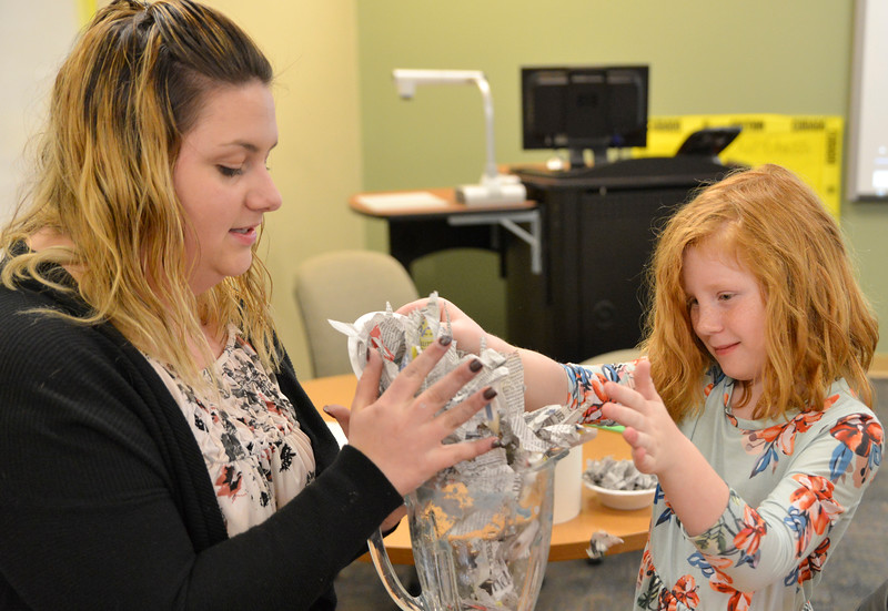 Justin Sheely | The Sheridan Press<br /> Education student Sydnea Lopez, left, and Woodland Park first-grader Abigail Kobielusz blend paper for a recycling demonstration during the Practicum in Education program at the Sheridan College Broadway Center Wednesday, April 4, 2018.