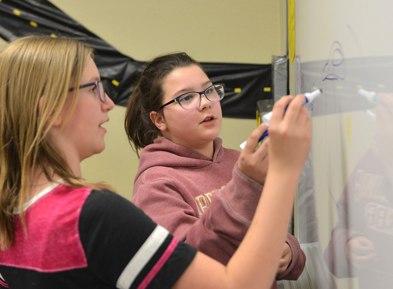 Justin Sheely | The Sheridan Press<br /> Meadowlark Elementary fifth-grader Bridgette Price, right, and Woodland Park fifth-grader Hailey Harding draw out a catapult plan during the Practicum in Education program at the Sheridan College Broadway Center Wednesday, April 4, 2018.