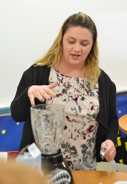 Justin Sheely | The Sheridan Press<br /> Education student Sydnea Lopez puts paper into a blender to demonstrate recycling during the Practicum in Education program at the Sheridan College Broadway Center Wednesday, April 4, 2018.