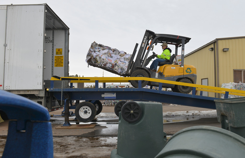 Justin Sheely | The Sheridan Press<br /> <br /> Stan Schwabauer loads bales of paper into a truck at the Sheridan Recycling Center Tuesday, Jan. 30, 2018. The city has seen a significant increase in recycled material along with a decrease in solid waste since they rolled out residential curbside recycling in 2015