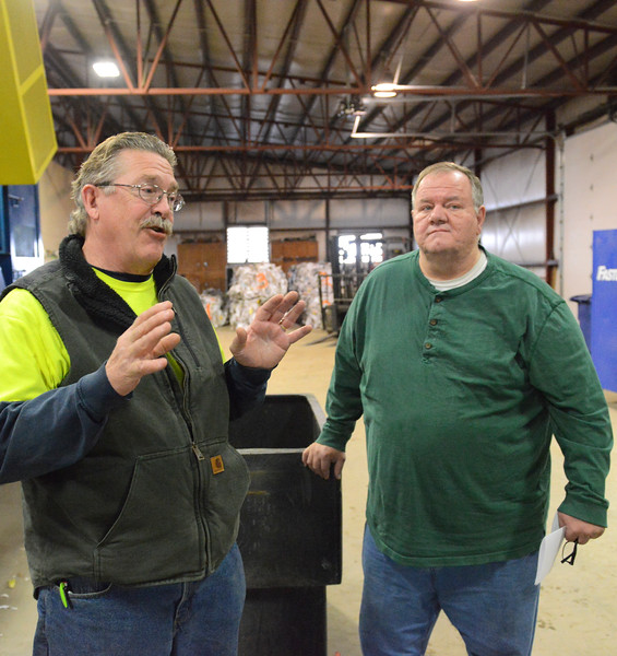 Justin Sheely | The Sheridan Press<br /> <br /> Sanitation supervisor Paul Larson, left, and solid waste superintendent Charles Martineau share about the progress at the Sheridan Recycling Center Tuesday, Jan. 30, 2018. The city has seen a significant increase in recycled material along with a decrease in solid waste since they rolled out residential curbside recycling in 2015
