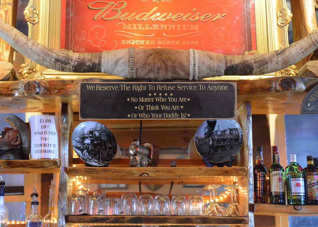 Justin Sheely   The Sheridan Press<br /> <br /> Various items hang from the wall above the bar at Rails Brews and Cues Tuesday, Jan. 23, 2018. Business owners Art Erickson and Linda Erickson will sell Rails Brews and Cues in March of 2018. The building was established in 1912.