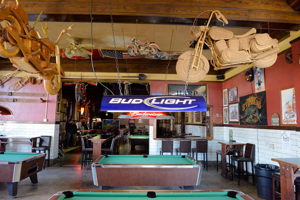 Justin Sheely   The Sheridan Press<br /> <br /> Pool tables stand under various decorations and bikes at Rails Brews and Cues Tuesday, Jan. 23, 2018. Business owners Art Erickson and Linda Erickson will sell Rails Brews and Cues in March of 2018. The building was established in 1912.