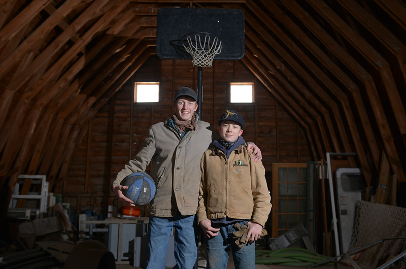 Justin Sheely   The Sheridan Press<br /> Arvada-Clearmont High School junior Tanner Klatt, left, and brother Cameron Klatt, freshman, stand in the second floor of a 100-year-old barn that holds a small basketball hoop. The brothers live on a ranch in Campbell County, about 40-miles from their high school in Clearmont. Their mother drives them 12 miles on a county road to the school bus pickup on U.S. Highway 14 east. Every day the brothers balance work on the ranch, school and playing on the Panthers basketball team.