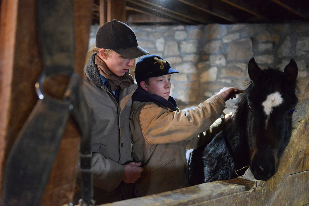 Justin Sheely | The Sheridan Press<br /> Arvada-Clearmont High School junior Tanner Klatt, left, and brother Cameron Klatt bring a foal in for feeding inside the barn at the Quarter-Circle 7 ranch near Arvada Friday, Dec. 22, 2017. The brothers live on a ranch in Campbell County, about 40-miles from their high school in Clearmont. Every day the brothers balance work on the ranch, school and playing on the Panthers basketball team.