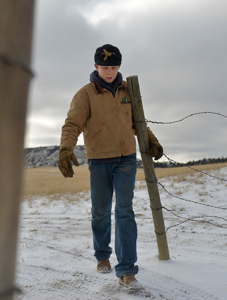 Justin Sheely | The Sheridan Press<br /> Arvada-Clearmont High School freshman Cameron Klatt closes a gate to the parcel holding the bulls at the Quarter-Circle 7 ranch near Arvada Friday, Dec. 22, 2017. The brothers live on a ranch in Campbell County, about 40-miles from their high school in Clearmont. Every day the brothers balance work on the ranch, school and playing on the Panthers basketball team.