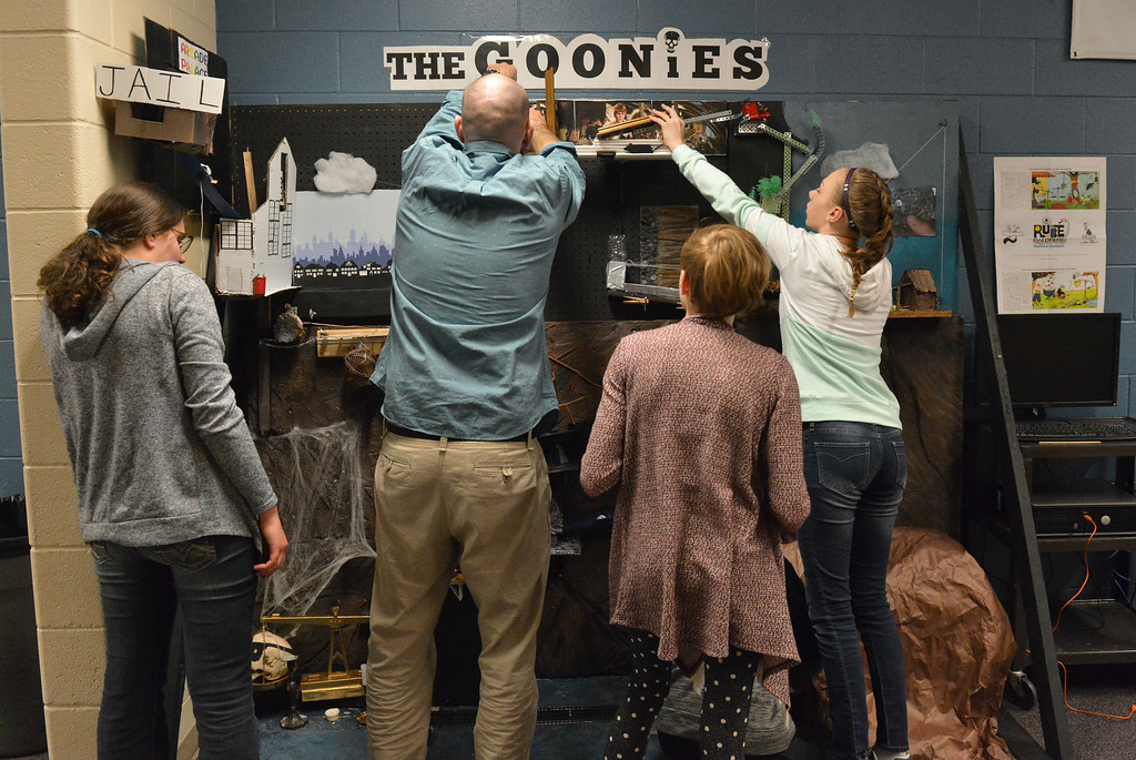 Justin Sheely | The Sheridan Press<br /> Ryan Fuhrman, center, leads his students in setting up their Goonies-themed Rube Goldberg machine for a test run at Sheridan Junior High School Tuesday, April 10, 2018. The students are entering their contraption to a competition online. Rube Goldberg was a Pulitzer Prize-winning American cartoonist who sketched absurd contraptions that accomplished simple tasks in complicated and humorous ways.