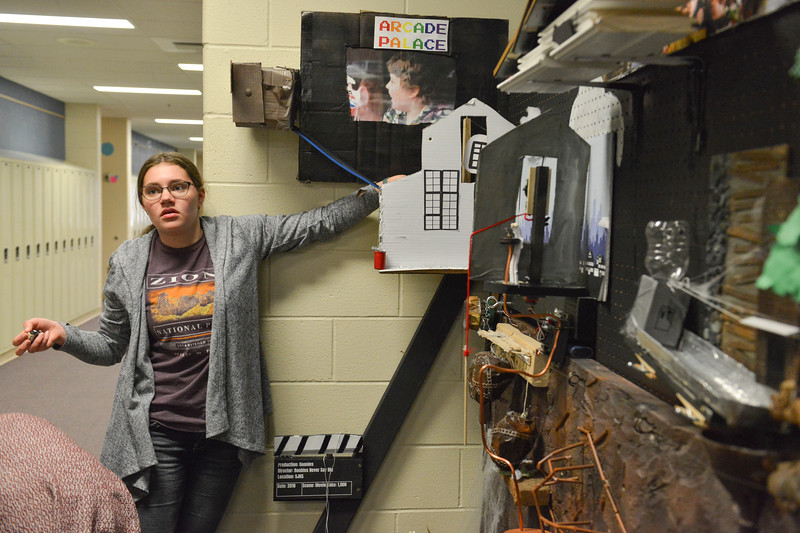 Justin Sheely | The Sheridan Press<br /> Eighth-grader Emerson Fuhrman sets a mechanism in their Goonies-themed Rube Goldberg machine at Sheridan Junior High School Tuesday, April 10, 2018. The students are entering their contraption to a competition online. Rube Goldberg was a Pulitzer Prize-winning American cartoonist who sketched absurd contraptions that accomplished simple tasks in complicated and humorous ways.