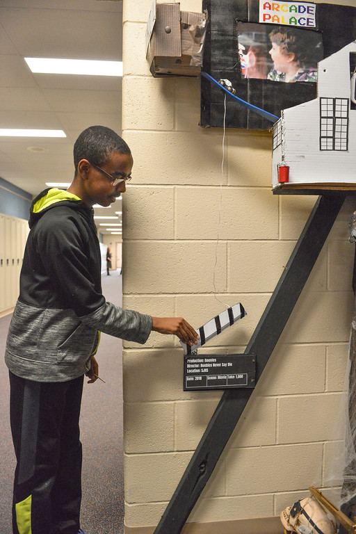 Justin Sheely | The Sheridan Press<br /> Sixth-grader Matthew Osborne triggers the Goonies-themed Rube Goldberg machine at Sheridan Junior High School Tuesday, April 10, 2018. The students are entering their contraption to a competition online. Rube Goldberg was a Pulitzer Prize-winning American cartoonist who sketched absurd contraptions that accomplished simple tasks in complicated and humorous ways.
