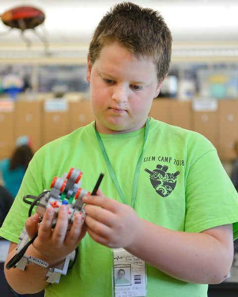 Justin Sheely | The Sheridan Press<br /> Sixth-grader Brody Leerssen builds a robotic hand during the Summer STEM Camp at Sheridan Junior High School Thursday, June 14, 2018. The STEM camp focused on biomedical engineering this year and students performed cow eyeball surgery, created and programmed robotic hands and made prosthetic legs.