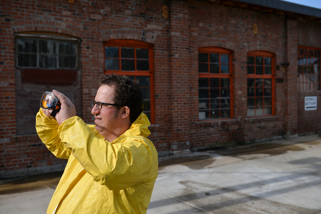 Justin Sheely | The Sheridan Press<br /> Kim Ostermyer wipes his safety glasses as he gears up for entering the old Sheridan Iron Works Building on Friday, May 26, 2017. Ostermyer, manager of the Wyoming Room in the Sheridan County Fulmer Public Library, is saving the logs, drawings, invoices and other records that has been kept in the attic of the brick building for more than 100 years. The work is slow, messy and hazardous due to the conditions of the attic, which contains decades of dust, water leaks, and dead birds. Ostermyer wears special equipment as precautions against any health risks. He says that the collection is valuable since the Sheridan Iron Works is one of the last of the oldest businesses in Sheridan to shut down. The record keeping the business had over the years was meticulous and stored over the years – a gold mine for any local historian.