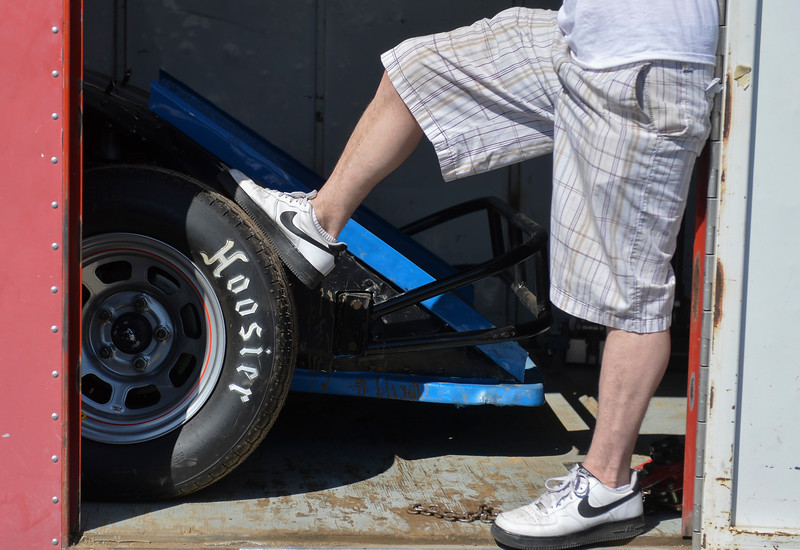Justin Sheely | The Sheridan Press<br /> Thomas Schwarzbach stands in a trailer as a driver prepares to back out the race car during the Sheridan Motorsports Association Car Show at the Holiday Inn Saturday, April 28, 2018.