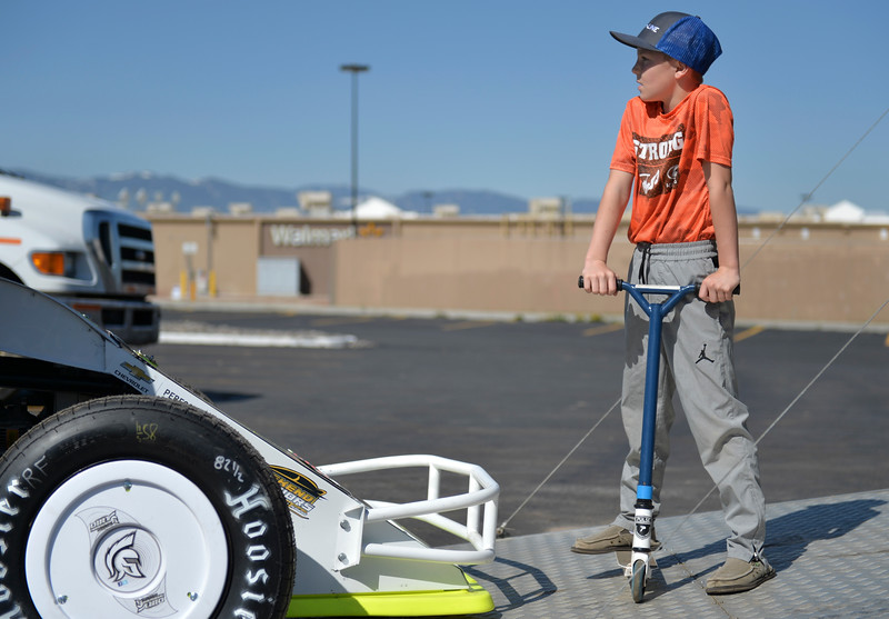 Justin Sheely | The Sheridan Press<br /> Nine-year-old Griffen Switzenberg looks on as his dad prepares for the Sheridan Motorsports Association Car Show at the Holiday Inn Saturday, April 28, 2018.