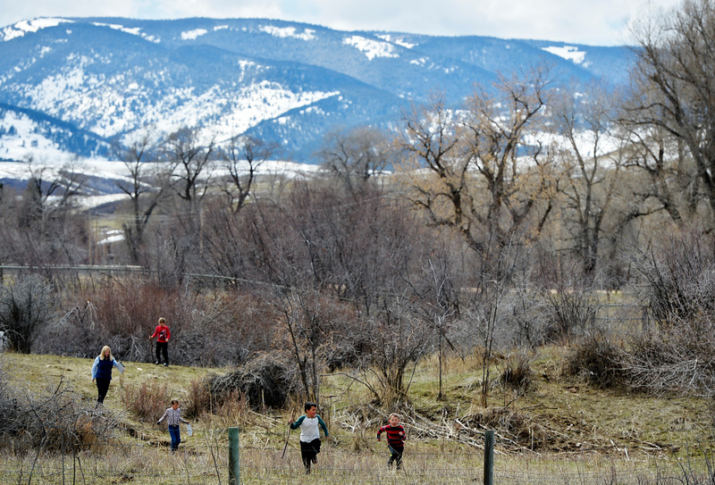 Justin Sheely   The Sheridan Press<br /> Slack School teacher Alice Kerns and students return to the building after a science walk in the area at Slack School near Parkman, Wyoming, Wednesday, April 18, 2018. Slack School is a one-room schoolhouse that began more than 100 years ago and serves students in kindergarten through fifth grade in Sheridan County School District 1.