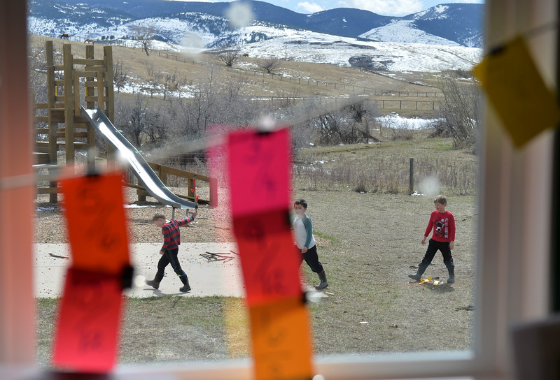 Justin Sheely | The Sheridan Press<br /> Students, from left, Ty Watkins, Marlis Johnson and TJ Watkins walk outside at Slack School near Parkman, Wyoming, Wednesday, April 18, 2018. Slack School is a one-room schoolhouse that began more than 100 years ago and serves students in kindergarten through fifth grade in Sheridan County School District 1.