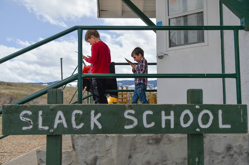 Justin Sheely | The Sheridan Press<br /> Third-grader TJ Watkins, left, Isaac Hartfeld use their iPads to look up a snake they saw at Slack School near Parkman, Wyoming, Wednesday, April 18, 2018. Slack School is a one-room schoolhouse that began more than 100 years ago and serves students in kindergarten through fifth grade in Sheridan County School District 1.