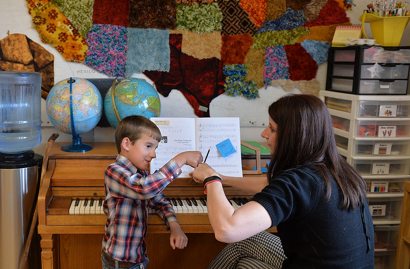 Justin Sheely | The Sheridan Press<br /> First-grader Isaac Hartfeld, left, wraps up a piano lesson with district employee Joy McArthur at Slack School near Parkman, Wyoming, Wednesday, April 18, 2018. Slack School is a one-room schoolhouse that began more than 100 years ago and serves students in kindergarten through fifth grade in Sheridan County School District 1.