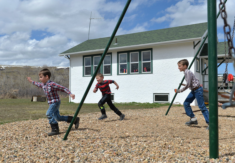 Justin Sheely | The Sheridan Press<br /> Students, from left, Isaac Hartfeld, Ty Watkins and James Hartfeld play a game at Slack School near Parkman, Wyoming, Wednesday, April 18, 2018. Slack School is a one-room schoolhouse that began more than 100 years ago and serves students in kindergarten through fifth grade in Sheridan County School District 1.