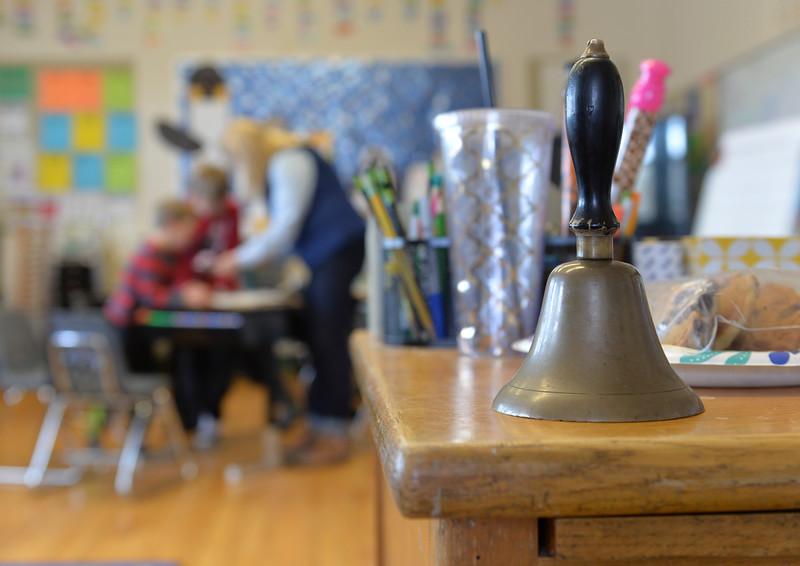 Justin Sheely   The Sheridan Press<br /> A bell sits on Alice Kerns' desk at Slack School near Parkman, Wyoming, Wednesday, April 18, 2018. Slack School is a one-room schoolhouse that began more than 100 years ago and serves students in kindergarten through fifth grade in Sheridan County School District 1.