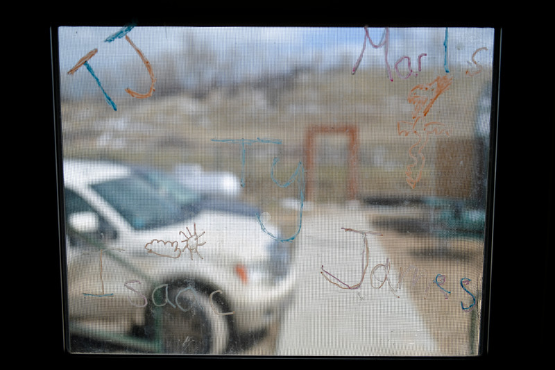 Justin Sheely | The Sheridan Press<br /> Student names are seen on a screen door at Slack School near Parkman, Wyoming, Wednesday, April 18, 2018. Slack School is a one-room schoolhouse that began more than 100 years ago and serves students in kindergarten through fifth grade in Sheridan County School District 1.