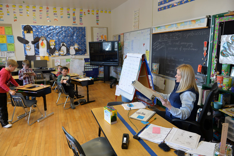 Justin Sheely | The Sheridan Press<br /> Teacher Alice Kerns, right, and the students take their seats at Slack School near Parkman, Wyoming, Wednesday, April 18, 2018. Slack School is a one-room schoolhouse that began more than 100 years ago and serves students in kindergarten through fifth grade in Sheridan County School District 1.