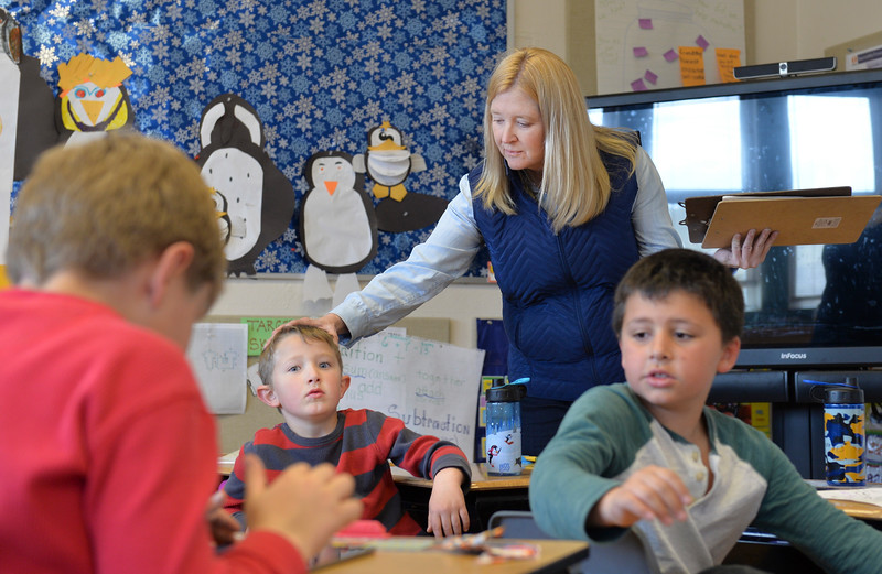 Justin Sheely | The Sheridan Press<br /> Teacher Alice Kerns, center, talks with Kindergartener Ty Watkins, left, as Marlis Johnson looks on at Slack School near Parkman, Wyoming, Wednesday, April 18, 2018. Slack School is a one-room schoolhouse that began more than 100 years ago and serves students in kindergarten through fifth grade in Sheridan County School District 1.