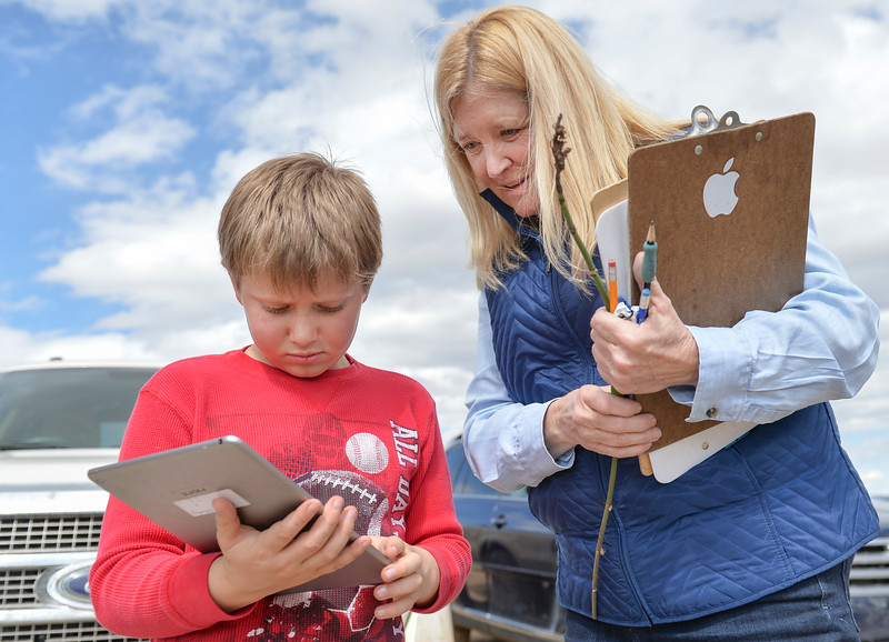 Justin Sheely | The Sheridan Press<br /> Third-grader TJ Watkins, left, looks up a snake on his iPad with teacher Alice Kerns at Slack School near Parkman, Wyoming, Wednesday, April 18, 2018. Slack School is a one-room schoolhouse that began more than 100 years ago and serves students in kindergarten through fifth grade in Sheridan County School District 1.