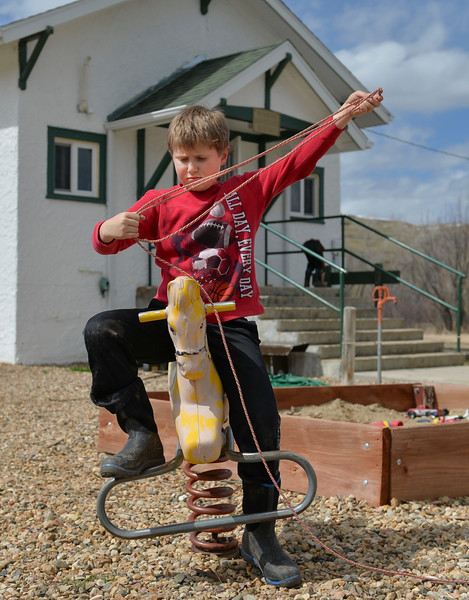Justin Sheely | The Sheridan Press<br /> Third-grader TJ Watkins practices his roping skills on the playground at Slack School near Parkman, Wyoming, Wednesday, April 18, 2018. Slack School is a one-room schoolhouse that began more than 100 years ago and serves students in kindergarten through fifth grade in Sheridan County School District 1.