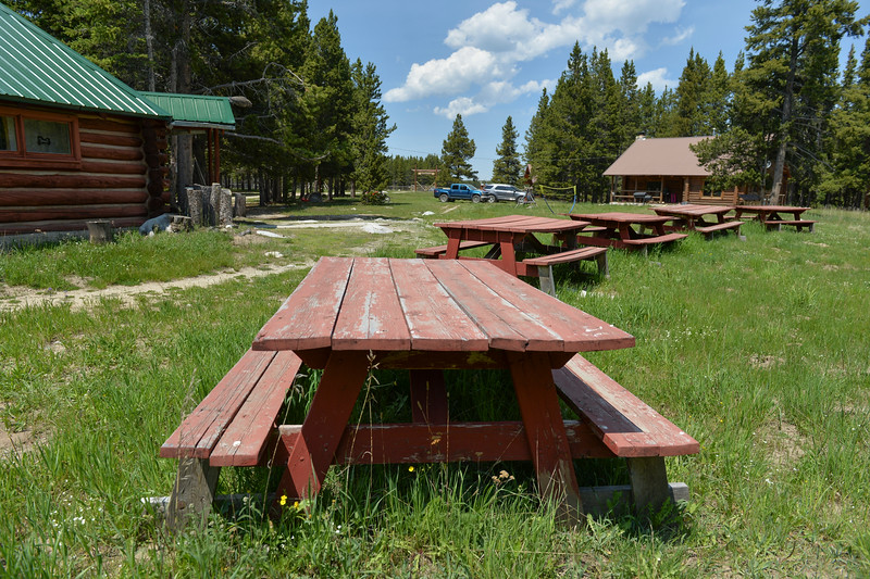 Justin Sheely | The Sheridan Press<br /> Picnic tables stand at Spear-O Wigwam in the Bighorn National Forest Thursday, June 28, 2018. The NWCCD board approved the potential sale on June 20 of Spear-O Wigwam, a 67,850-acre area in the Bighorn Mountains. The college leased the property since 2011 and used it for summer education programs and performances.